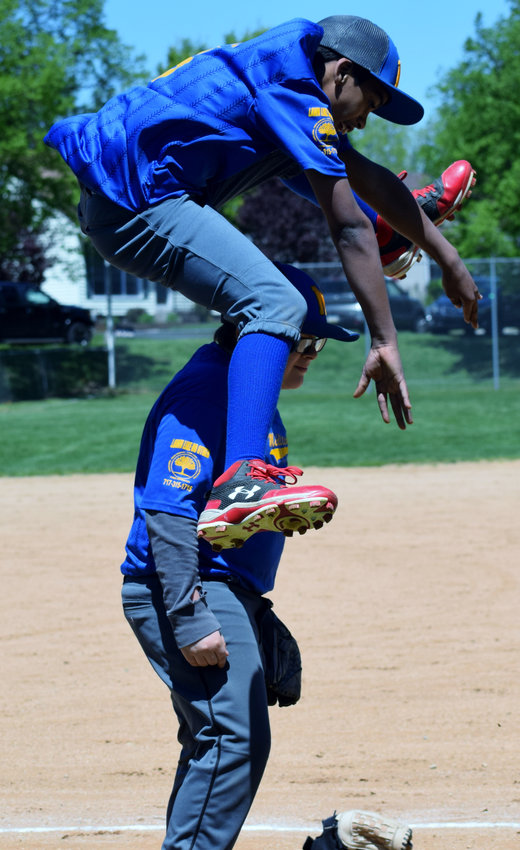 Jay Drupp jumps over Connor Hipple during the opening day of the 60th anniversary of the Middletown Amateur Baseball Association on Saturday, April 27.