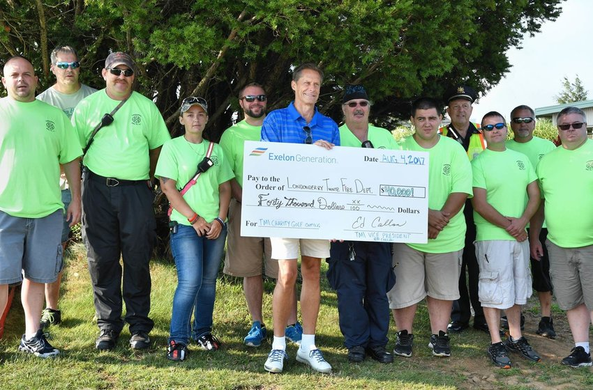 TMI Vice President Ed Callan presents Londonderry Township Fire Department a check for $40,000 on Aug. 4, 2017, during a golf outing at Sunset Golf Course.