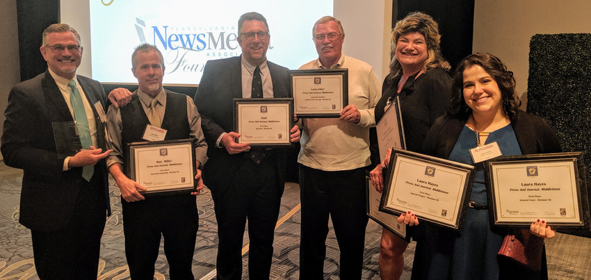 Press & Journal Publisher Joseph G. Sukle Jr., reporter Dan Miller, Editor Jason Maddux, sports reporter Larry Etter, creative director Julianna Sukle and reporter Laura Hayes hold some of the paper's 2019 Keystone Press Awards that were handed out Saturday at the Harrisburg Hilton during the Pennsylvania Press Conference. The Press & Journal won 14 awards, including being selected as the best newspaper of its size in the state.