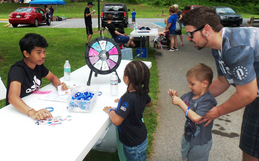 Youngsters could spin the wheel for prizes after answering age-appropriate questions about drug and alcohol use at Family Fun Day on Saturday at Hoffer Park.