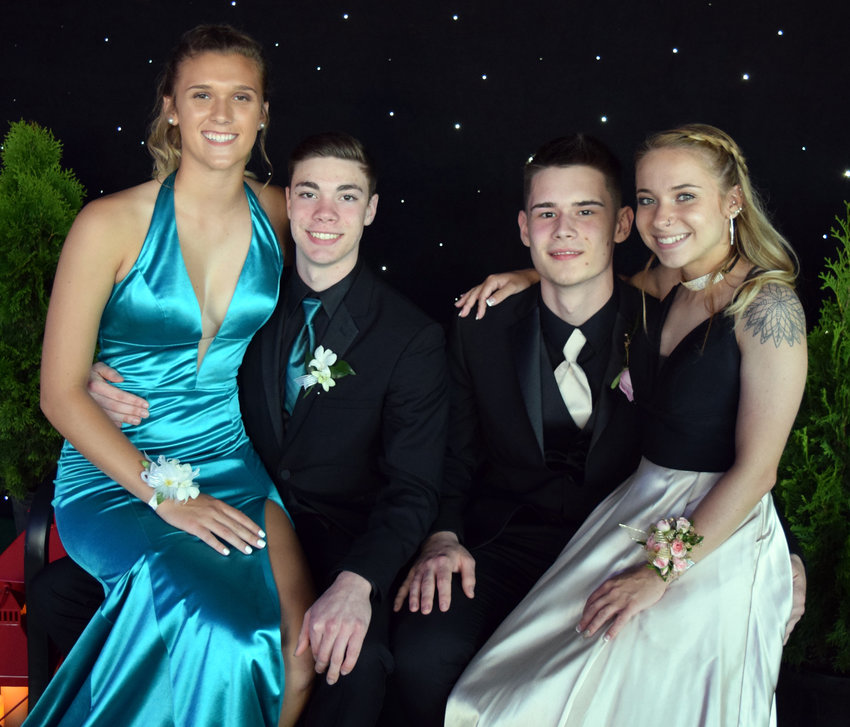 Alex Kennedy, Jesse van Eik, Hunter Martnishn and Abrielle Spagnolo attend the Middletown Area High School prom on May 18.