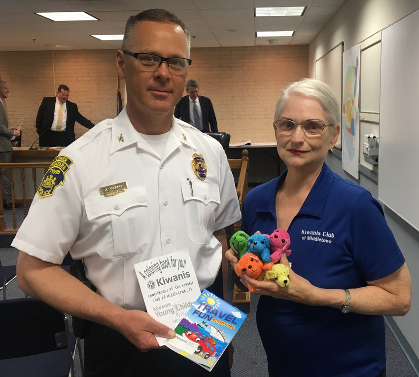 Melody Wilson of the Kiwanis Club of Middletown presents donated stuffed animals and coloring books to Lower Swatara Police Chief Jeff Vargo at a board of commissioners meeting May 1. The Kiwanis have donated items to the Middletown Police Department since 2014 and added Lower Swatara Township this year.