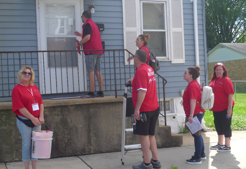 A team of volunteers working for the Red Cross knock on the door of a home on South Pine Street in Middletown during the Sound The Alarm event held on Friday, May 31. Teams of volunteers knocked on the doors of more than 950 residences throughout the borough, with the goal of installing at least 600 free smoke alarms. The Red Cross also trained the volunteers in how to educate borough residents on fire safety during the event. Giant Foods provided 75 volunteers to support the event, and volunteers were also provided by UGI.