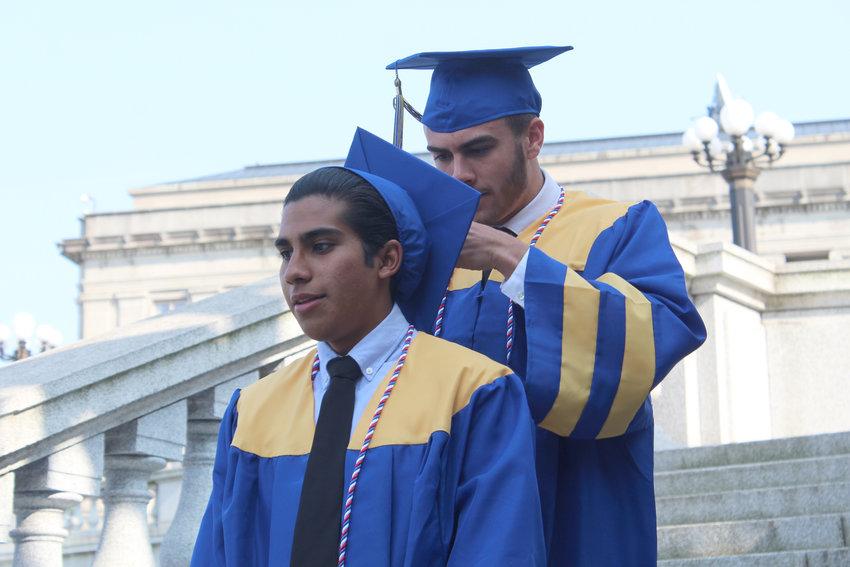Tanner Albright adjusts Edgar Lopez's tassel before MAHS graduation on June 4.