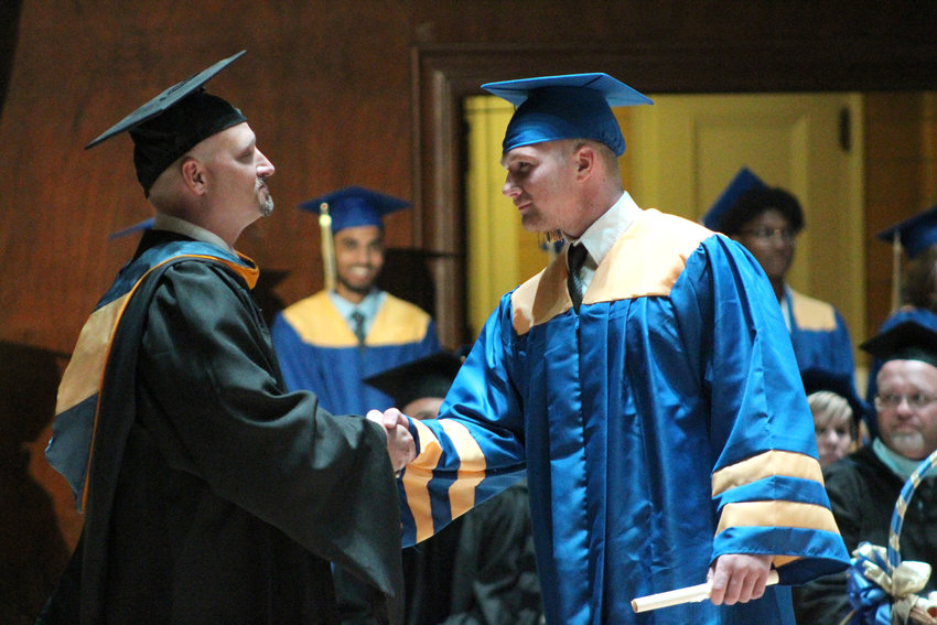 Ethan Miller shakes hands with MAHS Principal Michael Carnes during graduation June 4, 2019.