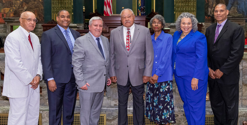 Sen. Mike Folmer, third from left, and the rest of the Pennsylvania Senate honored former Middletown Mayor Robert Reid, center, on Monday with a citation recognizing his more than 50 years of service to the borough.
