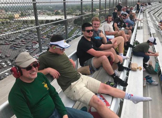 Troop 97's Mike Harris, Ben Spangenberg, Cole Carlson, Mason Swartz, Owen Wealand, Matt Pauley and, seated on lower riser, Bryson Harris at Dover International Speedway in May.