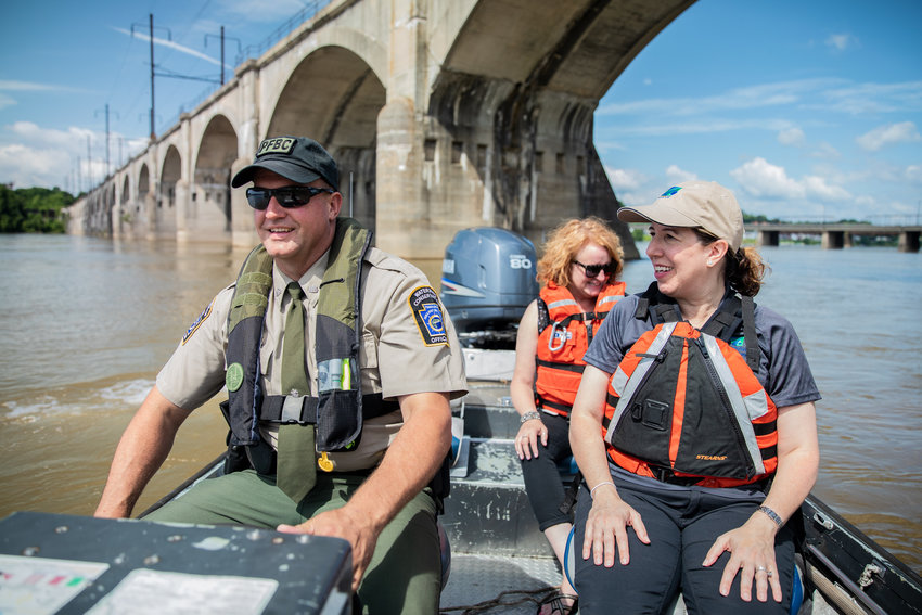 Water Conservation Officer Mark Sweppenhiser of the Pennsylvania Fish and Boat Commission takes PennDOT spokeswoman Fritzi Schreffler and PennDOT Secretary Leslie S. Richards out onto the Susquehanna River during an event held June 25 at the City Island boat launch, urging safe and responsible celebrations.
