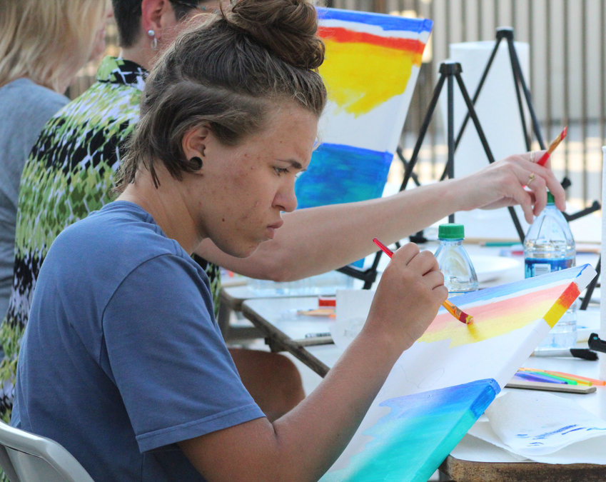 Maleah Sisti paints during a paint night at the Middletown Community Pool on June 27.