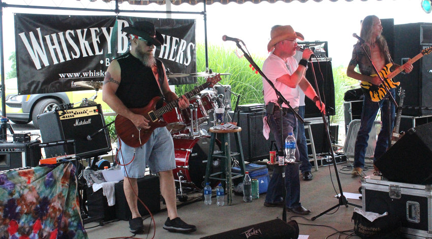 The Whiskey Brothers Band perform at Sunset Bar and Grill during the Stars and Stripes Salute June 29.