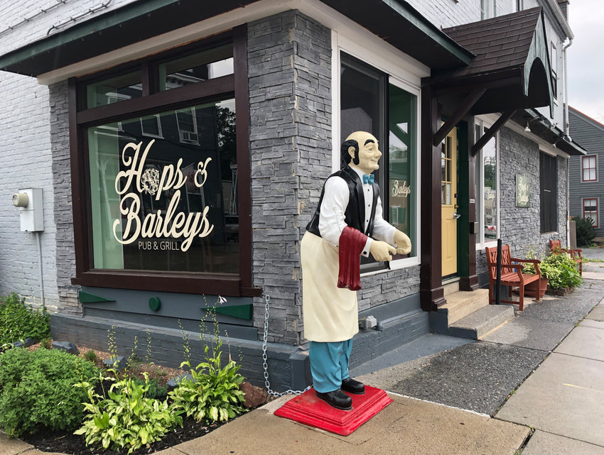"""""""Seamus"""" again stands watch outside of Hops & Barleys Pub and Grill on East Main Street."""