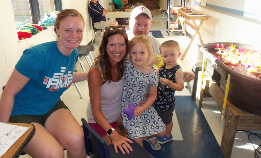 Volunteer Carolyn Ciccocioppo, left, was on hand at Seven Sorrows Community Days on July 12 to do children's face painting and temporary tatoos. She is joined here by Sam and Zoe Martin of Middletown with the Martins' grandchildren, Mabel Mathias, 4, and Lucas Mathias, 2.