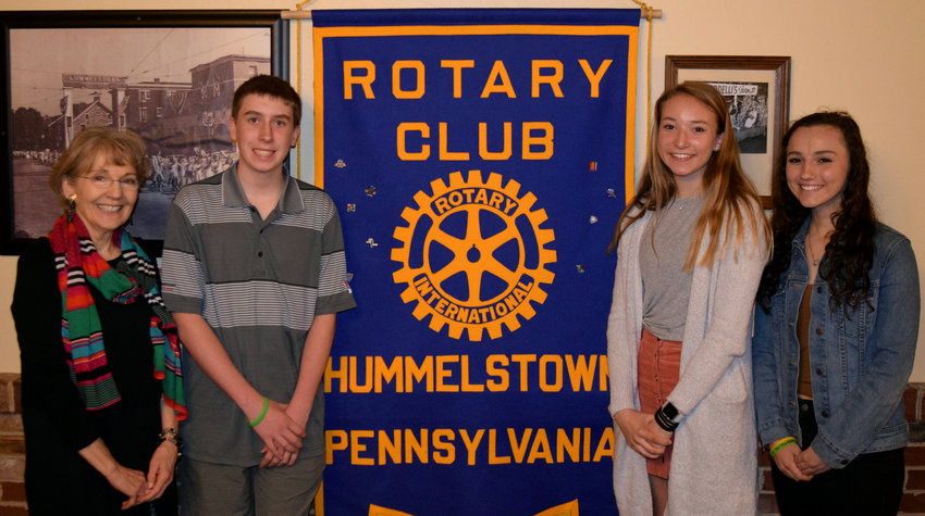 "Lower Dauphin High School freshman Aidan Powell recently won first place in the annual Hummelstown Rotary Club Four-Way Test Writing Contest. The Four-Way Test espouses Rotary's guiding principles as a moral code for personal and business relationships, according to the organization. The test asks Rotarians to consider four things prior to making a decision — ""Is it the truth?""; ""Is it fair to all concerned?""; ""Will it build goodwill and better friendships?""; and ""Will it be beneficial to all concerned?"". Powell's essay was about repairing, refurbishing and donating bicycles to those in need. Classmates Delanie Batula took second in the contest and Emily DeNotaris was third. Honorable mentions included Britley Brubaker, Jack Francis, Lucy McCurdy, Abigail Perez and Carlos Rodriguez. Above, Lower Dauphin High School English teacher Karen Burk poses with students Powell, Batula and DeNotaris."