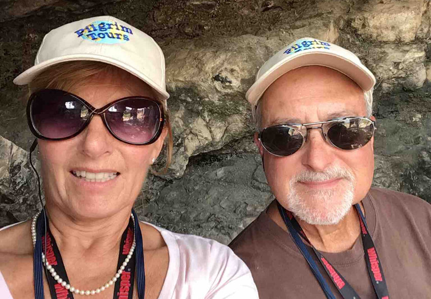 Scott and LaVonne Ackerman take a selfie in a cave.