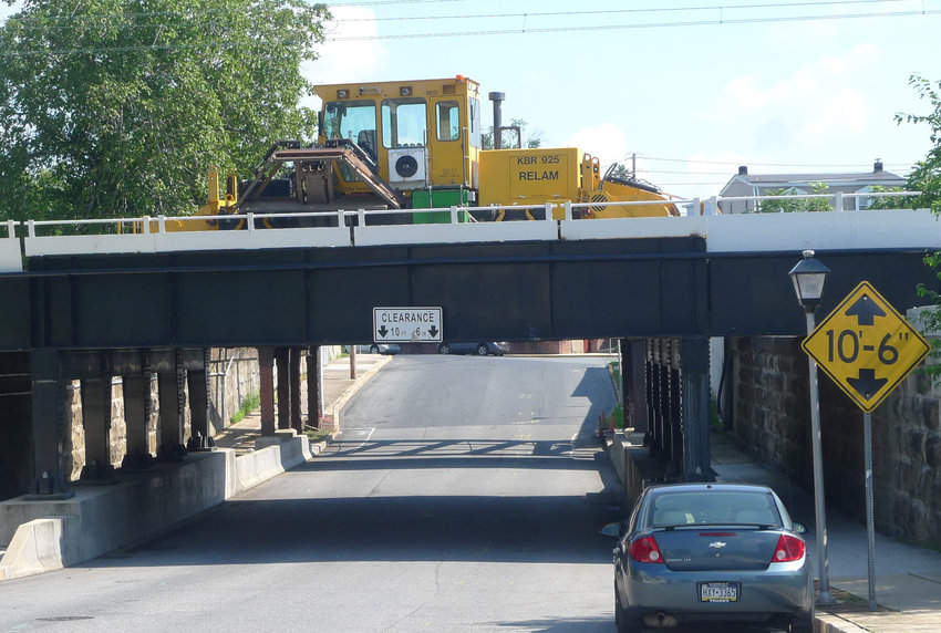 Track relocation work, such as the railroad bridge passing over Wood Street where this equipment is staged, is crucial before construction of the new Amtrak train station can begin. The relocation work is proceeding as scheduled, PennDOT tells the Press & Journal.