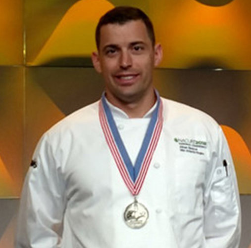 Penn State Harrisburg executive chef Athan Spanos had the winning dish at the 2019 National Culinary Challenge. It featured a juniper and fennel crusted venison chop, delicata squash and trumpet royale mushroom hash, sunchoke ravioli truffle parmesan foam, root vegetable chip, and a sour cherry reduction.