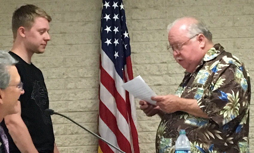 Lower Swatara Board of Commissioners President Jon Wilt swears in Tyler Ross as a Lower Swatara fire police officer during the July 17 meeting. According to the fire department website, there are two fire police officers in addition to the captain and lieutenant.
