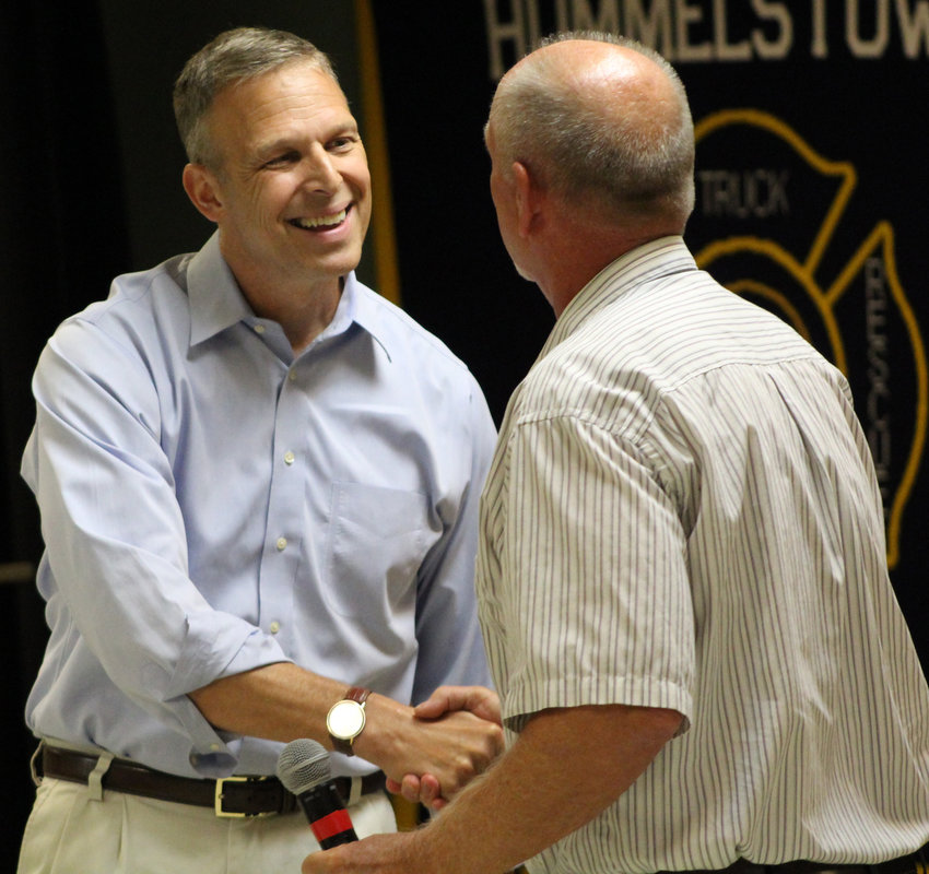 Congressman Scott Perry shakes hands with Hummelstown Mayor David Roeting during his town hall at the Hummelstown Fire Department on July 30.