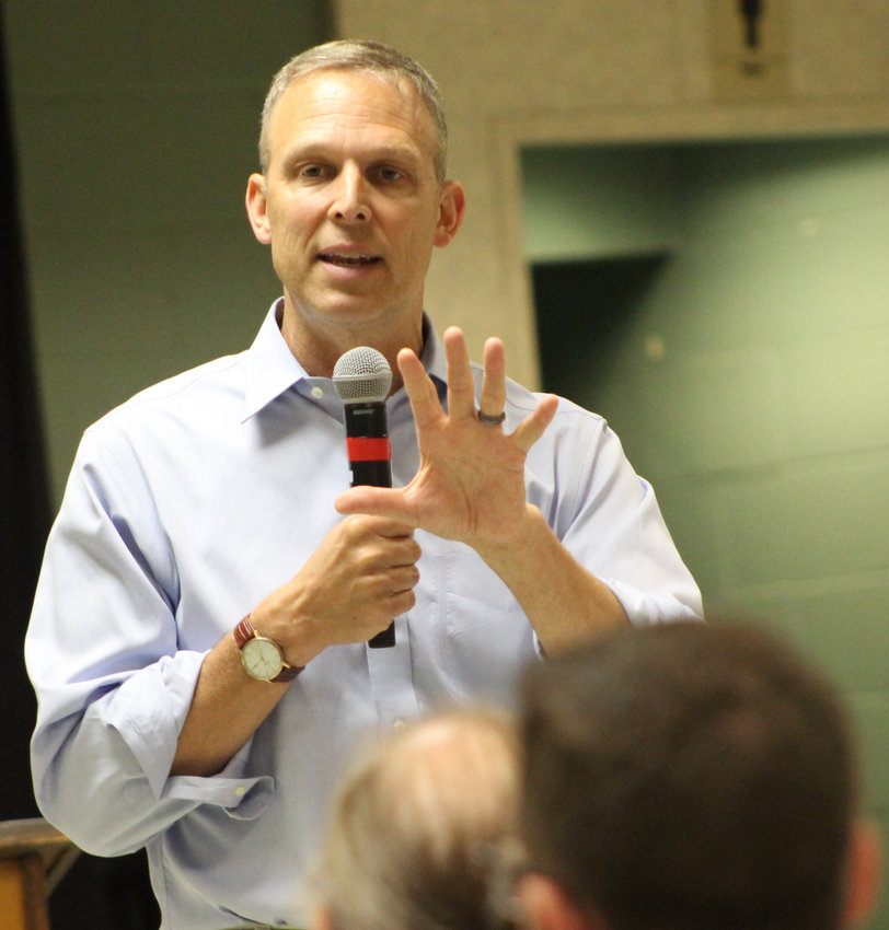 Congressman Scott Perry responds to an audience member's questions during his town hall on July 30 at Hummelstown Fire Department.
