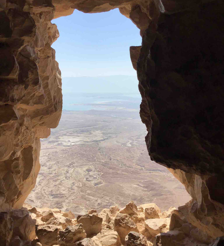 Standing in Masada, looking out an opening at the Dead Sea.