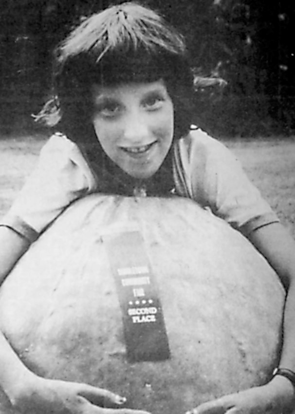 Peggy Lutz's entry at the Middletown Community Fair took a second-place finish. Tipping the scales at 60 to 65 pounds, the mammoth fruit was so large that the 10-year-old rural Middletown youth could barely stretch her arms around it.