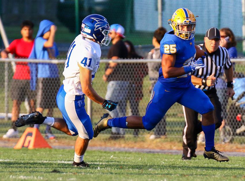 Blue Raider running back Jose Lopez sizes up Lower Dauphin defender Jason Tomasic in Middletown's 34-12 season-opening win Friday, Aug. 23, at War Memorial Field.