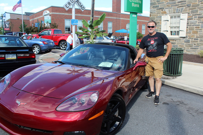 Troy White poses with his C6 Z51 model during Kuppy's Diner Cruise-in Aug. 29.