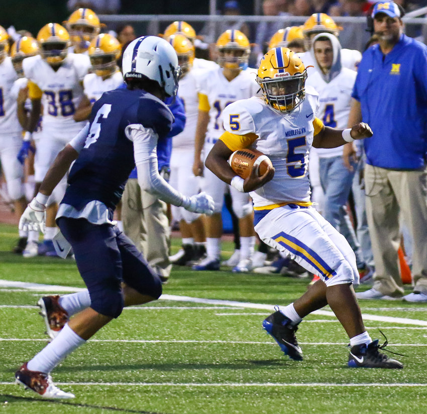 Tymir Jackson cuts back while recording some of his 327 rushing yards Friday against Camp Hill.