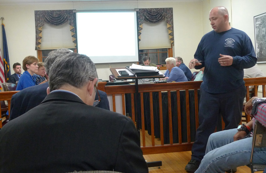 Middletown Fire Chief Kenton Whitebread Jr. (standing) questions representatives of Middletown Water Joint Venture (seated in the audience) during the Sept. 17 Middletown borough council meeting.