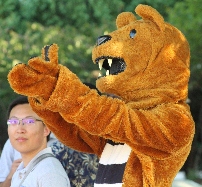 The Nittany Lion applauds after Global Ambassadors perform in a showcase as part of We Are Weekend at Penn State Harrisburg on Sept. 28.