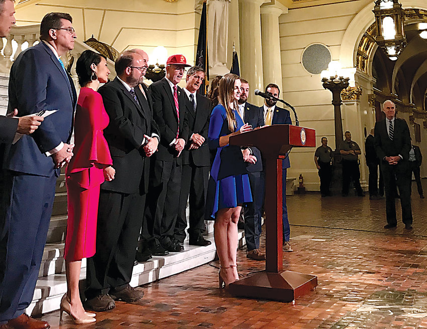 Middletown resident Alexandra Curry speaks Thursday in the state capital Rotunda about being the sponsor of a new U.S. Navy Ship, the USS Harrisburg.