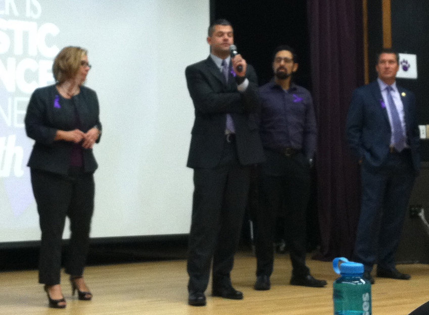 Middletown police Patrolman Keegan Wenner (holding microphone) speaks during the Oct. 17 domestic violence awareness event at Penn State Harrisburg. On the left is Dauphin County Chief Deputy District Attorney Jen Gettle, and state Rep. Tom Mehaffie is on the right.