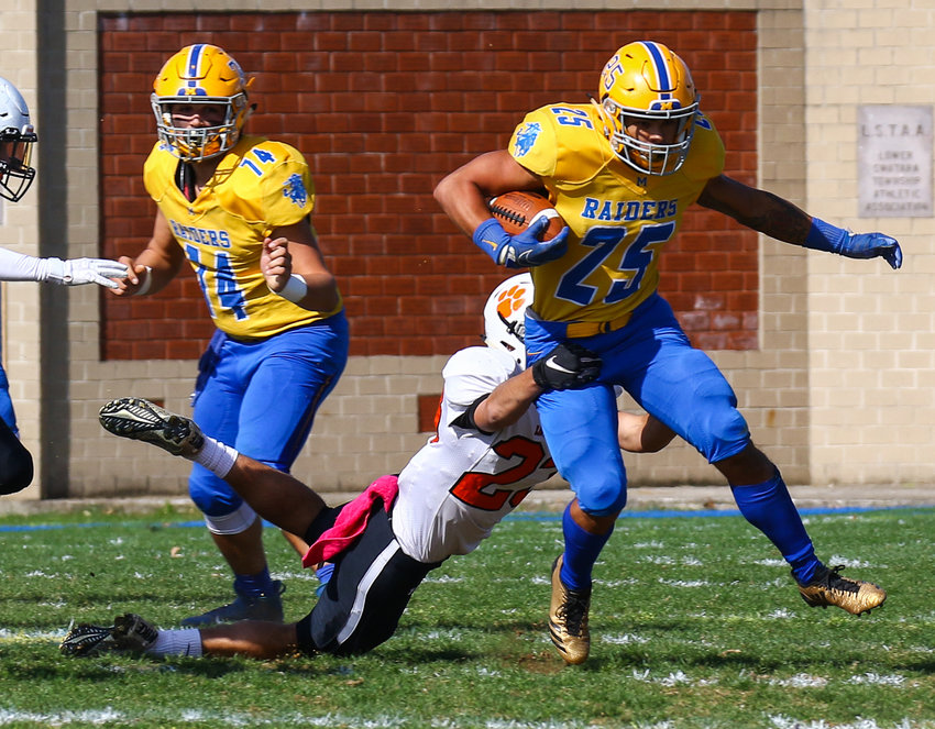 Jose Lopez breaks the tackle of an East Pennsboro defender during a Homecoming win Saturday at War Memorial Field.