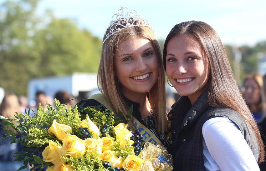 Best friend Kiera Guckavan congratulates Maria Schopf after she was crowned Homecoming queen.