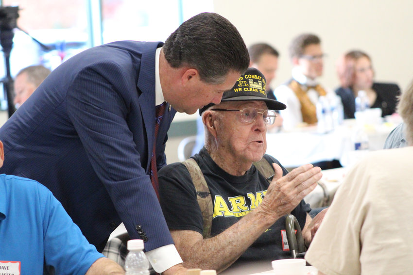 Rep. Tom Mehaffie talks with World War II Army veteran Charlie Schoell during his Veterans Breakfast at the Lower Swatara Fire Hall Nov. 8. World War II veterans were honored during the breakfast.