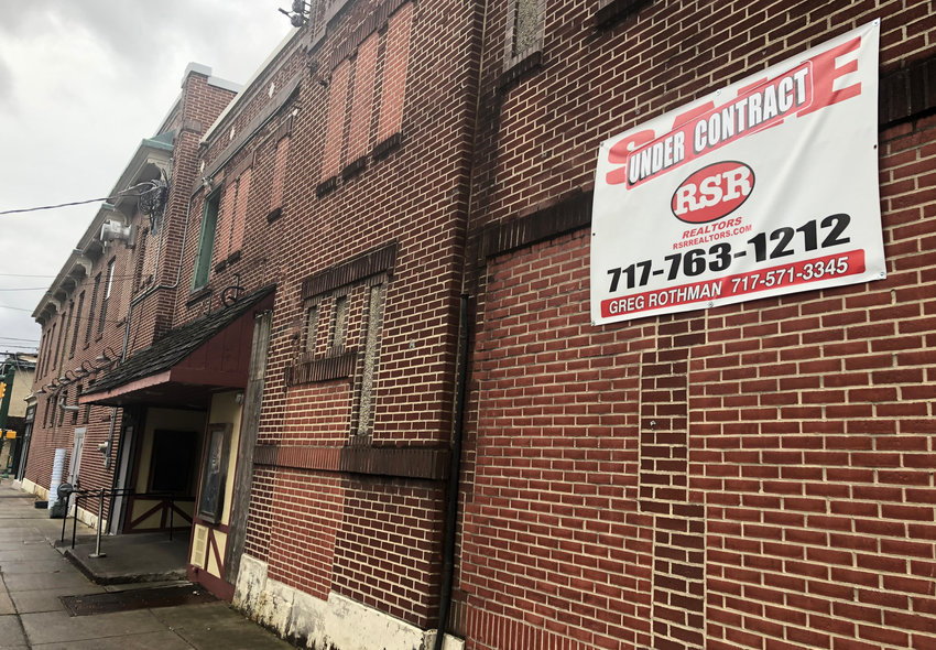 "An ""Under Contract"" sign remains on the Elks Theatre building on Tuesday morning, despite the fact that Industrial and Commercial Development Authority member Ian Reddinger told the Press & Journal on Monday that a potential deal has fallen through."