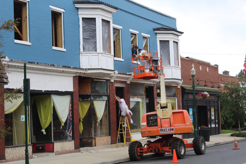 Crews work on the property known as Bunky's on South Union Street on July 11.