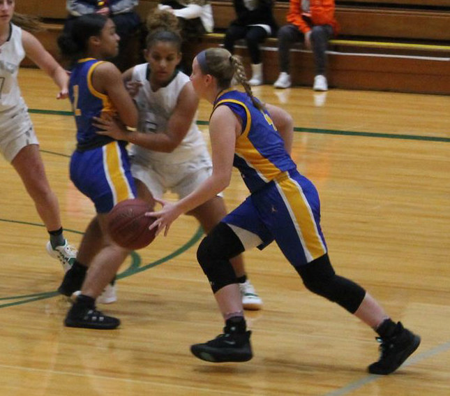 Kate Fitzpatrick drives by Trinity defenders in Friday's 56-46 loss.