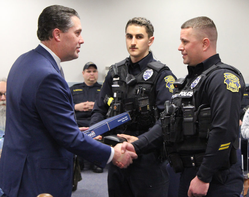 Rep. Tom Mehaffie honored Lower Swatara Officers Josh Malott, right, and Tim Shea during the Jan. 15 Board of Commissioners meeting.