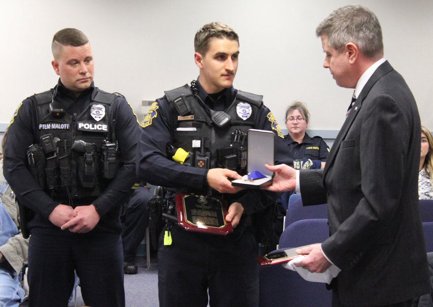 Dauphin County District Attorney Fran Chardo presented Officers Josh Malott, left, and Tim Shea with the Medal of Valor during the Jan. 15 Board of Commissioners meeting.