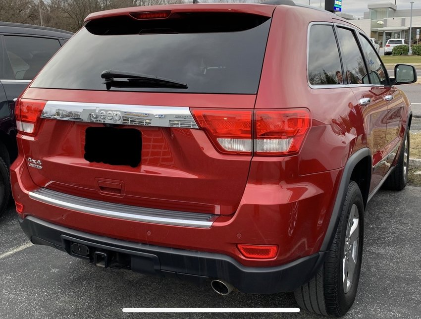 A 2011 to 2016 red Jeep Grand Cherokee, similar to the one pictured above, is being sought.