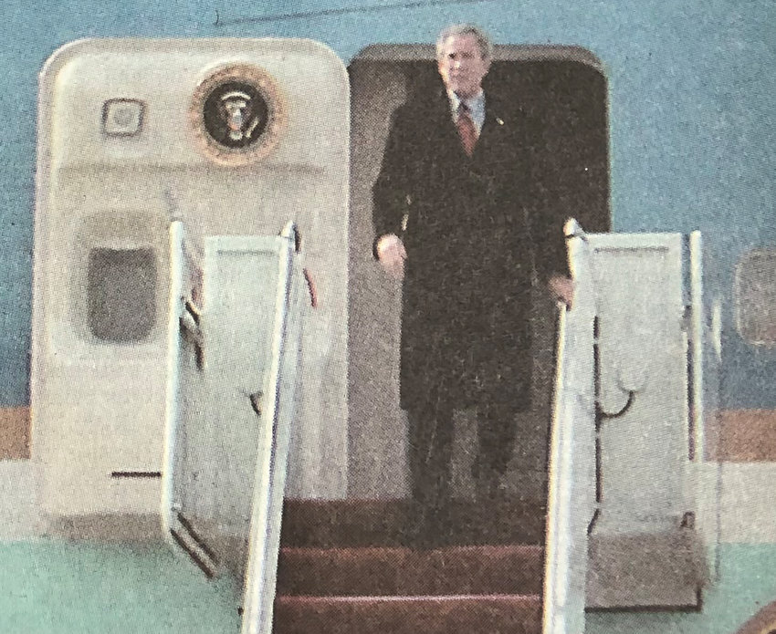 President George W. Bush exits the plane and greets onlookers. The president was in town to promote his education initiatives Thursday, Feb. 12, 2004. He spoke at Central Dauphin High School in suburban Harrisburg.