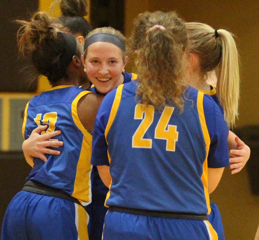 Middletown senior standout Kate Fitzpatrick celebrates with teammates Feb. 4 after setting the Blue Raider girls record for points scored in a career during a game at Milton Hershey.