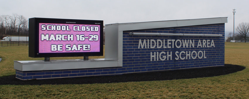 The sign in front of Middletown Area High School on March 16 reminded students that the school is closed, at that point through March 29.