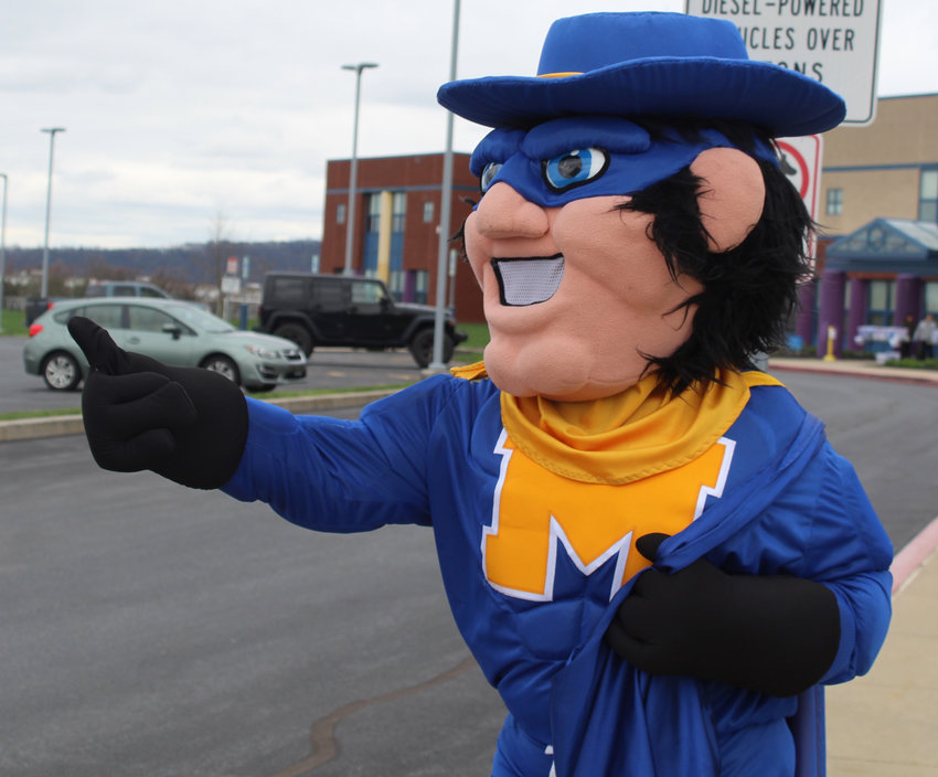 The Middletown Blue Raider mascot gives a thumbs-up to students and parents who came to Reid Elementary School on March 31, 2020, to pick up their iPads.