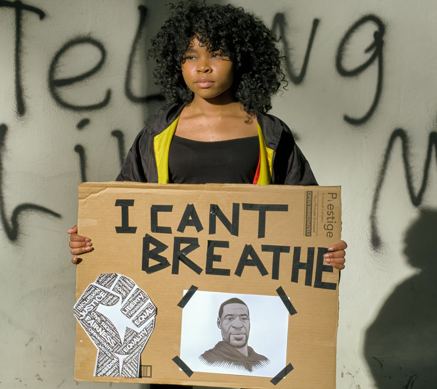 A protester in Washington, D.C., holds a sign featuring George Floyd during a recent event.