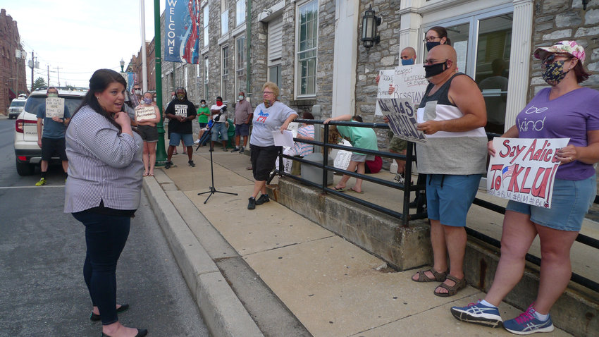 "Democratic candidate for the 106th state House seat Lindsay Drew of Derry Township addresses protesters outside the MCSO before the start of the Middletown Borough Council meeting. James Noon, wearing a black T-shirt directly below the ""Welcome"" banner, later spoke at the borough council meeting."