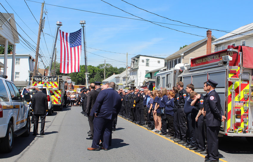Loved ones, firefighters, and other first responders line up in front of Matinchek Funeral Home on June 16 to honor Lower Swatara Fire Department President Michael McKillip, who passed away June 6.