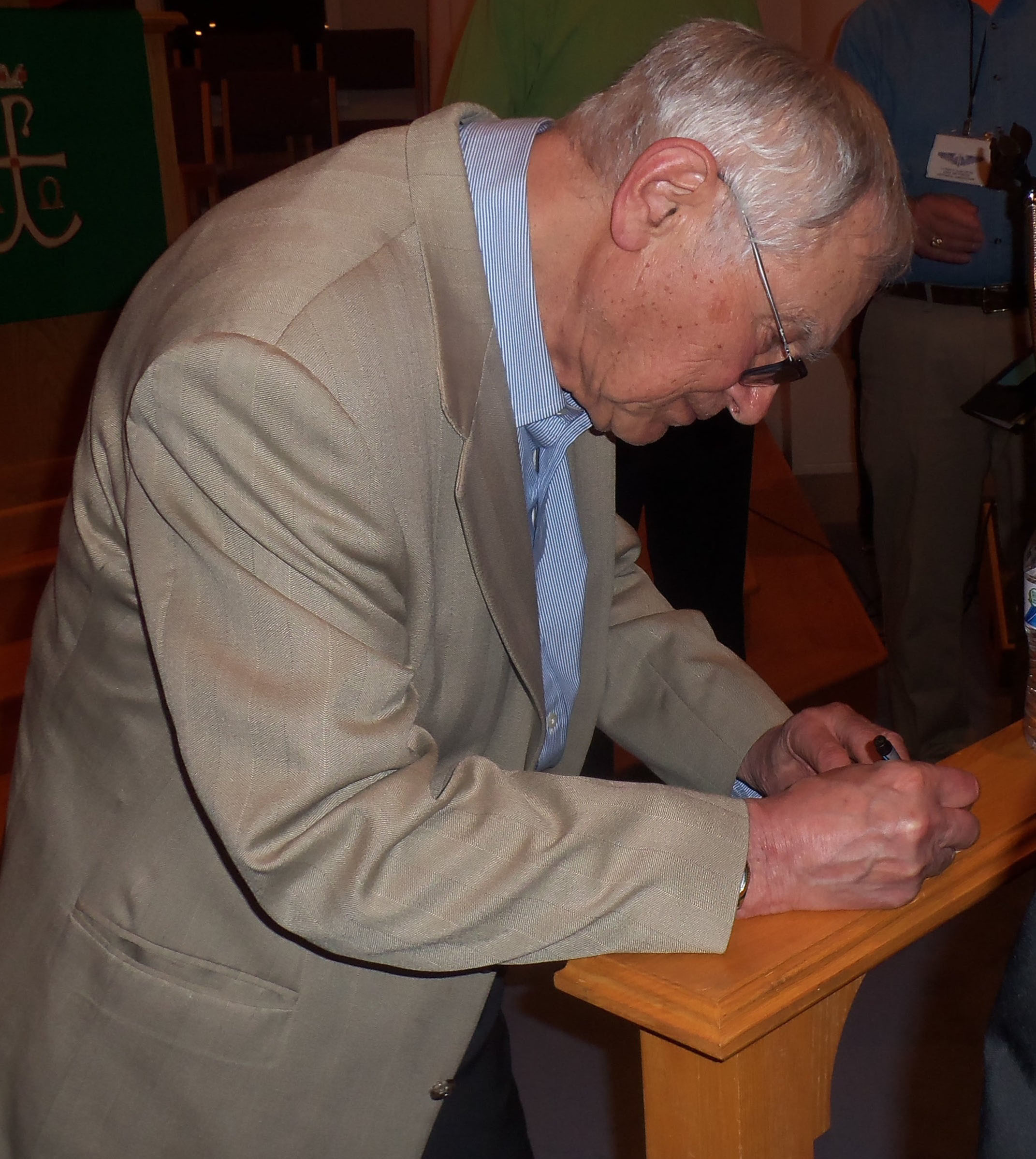 Holocaust survior Ernie Gross signs an autograph for a young admirer at the Central Pennsylvania WWII Roundtable held March 2 at Grace United Methodist Church, Hummelstown.