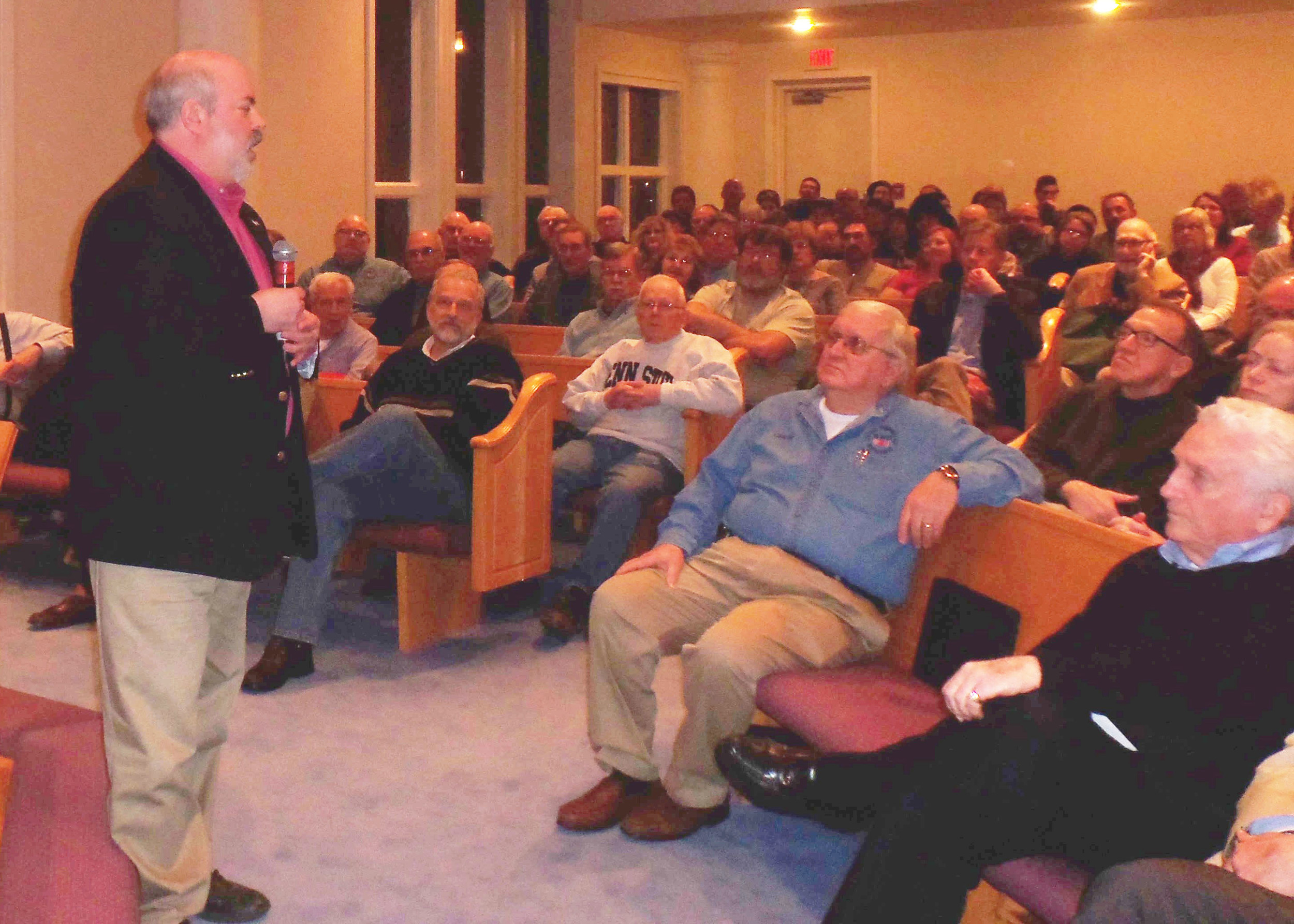 Steve Gross, son of Holocaust survivor Ernie Gross, introduces his father and World War II Army veteran Don Greenabaum to the crowd at the Central Pennsylvania Roundtable at Grace United Methodist Church, Hummelstown, on March 2. Greebaum liberated Gross from a German concentration camp in April 1945.